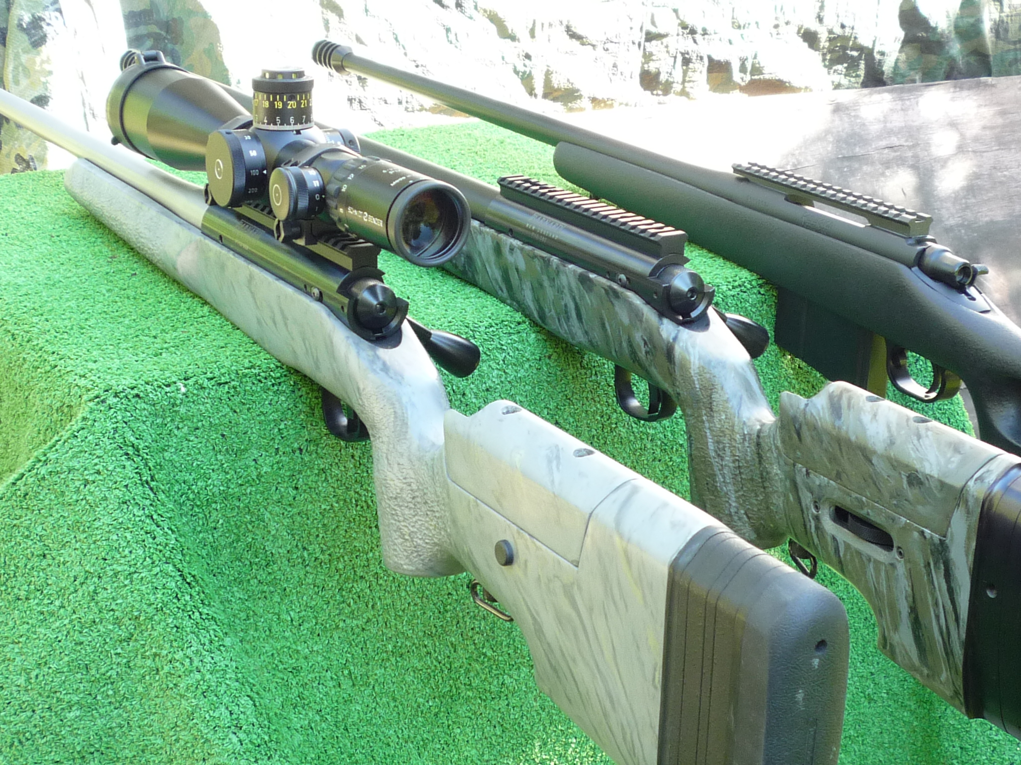 3 custom rifles together