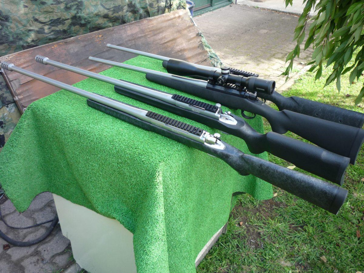 4 custom rifles together